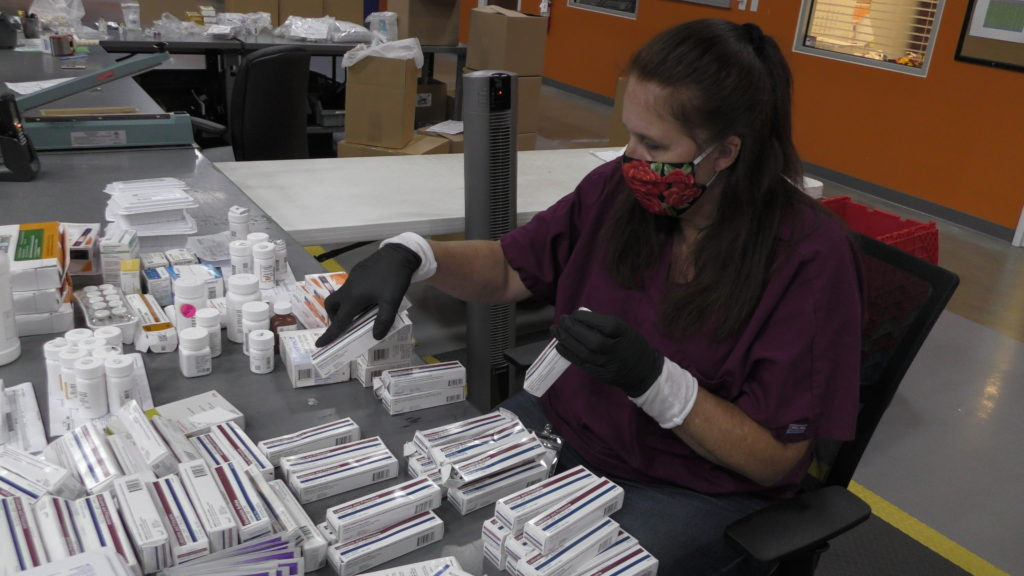 Charlotte Daniels packing products for return shipment